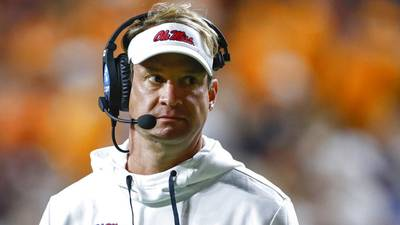 Tennessee fans throw trash on field, hit former coach Lane Kiffin after Ole Miss win